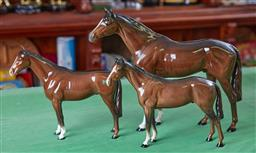 Sale 9103H - Lot 80 - Three Beswick horses, Largest Length 35cm together with a book on Beswick animals.