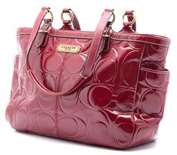 Sale 9132 - Lot 352 - A COACH GALLERY EMBOSSED PATENT LEATHER TOTE BAG; deep cherry red with gold tone hardware, pale pink sateen lining, internal zip poc...