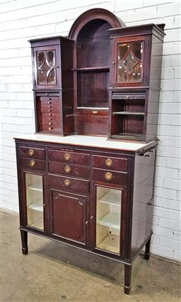 Sale 9179 - Lot 1013 - Early 20th Century The American Cabinet Co dentists cabinet, the central arched niche flanked by astragal doors & tambour shutter...