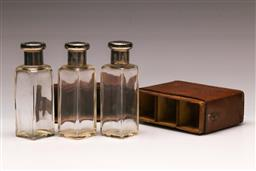 Sale 9128 - Lot 3 - A leather cased set of three scent bottles with silver lids