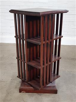 Sale 9215 - Lot 1027 - Edwardian Revolving Bookcase, of three tiers, raised on plinth base - area of damage to plinth (h:105 x w:50cm2)