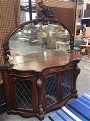 Sale 8882 - Lot 1017A - Victorian Figured Walnut Credenza, with grape carved mirror back, above a serpentine front with four later lead-light panel doors