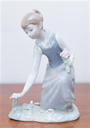 Sale 8369A - Lot 11 - A Lladro figure of a girl picking flowers, H 21cm