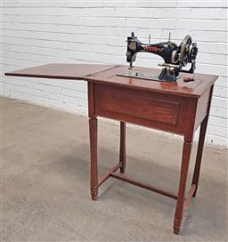 Sale 9134 - Lot 1570 - Vintage Vickers sewing machine in elevated case (h:81 x w:59 x d:43cm)