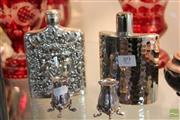 Sale 8217 - Lot 89 - Hip Flasks with a Pair of Footed Tooth Pick Holders