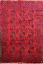 Sale 8740 - Lot 1098 - Afghan Turkoman Wool Carpet, with guls, all in deep red & black tones (300 x 200cm)