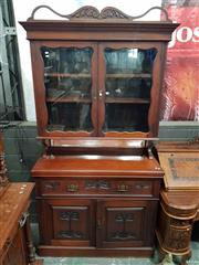 Sale 8917 - Lot 1035 - Edwardian Carved Blackwood Secretaire Bookcase, with two shaped glass panel doors, fitted fall-front drawer & two timber panel doors...