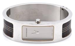 Sale 9132 - Lot 367 - A LADYS BURBERRY BANGLE WATCH; ref. 14300L in stainless steel with brushed dial and check material shoulder inserts, ETA quartz mov...