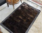Sale 8205 - Lot 34 - A Ralph Lauren contemporary rabbit skin rug in brown brick effect, with mock croc leather surround, approx 116 x 177cm