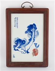 Sale 8536 - Lot 90 - A Republic style blue and white plaque decorated with cabbage and raddish, Wangbu mark to the top, 41cm x 30cm