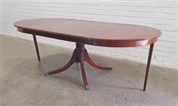 Sale 9126 - Lot 1208 - Late Georgian Style Mahogany Extending Dining Table, with turned centre pedestal and outswept feet, the round top extended by two le...