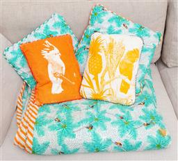 Sale 9150H - Lot 163 - A group of four small colourful cushions in a tropical design, together with a quee sized bed toppers