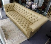 Sale 8205 - Lot 35 - A Ralph Lauren gold upholstered button back chesterfield of large proportions, Width 254cm