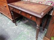 Sale 8559 - Lot 1029 - Victorian Mahogany Leather Top Desk, with three short drawers & turned reeded legs