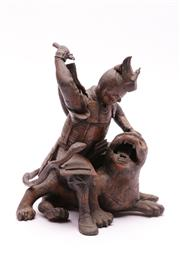 Sale 9023 - Lot 30 - A Bronze Figure of A Warrior and Beast (H 21cm some losses apparent)