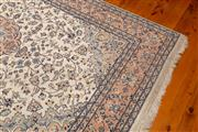 Sale 8774A - Lot 6 - A woollen Persian rug with central medallion on cream ground, measuring 186cm x 290cm