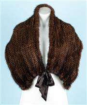 Sale 9083F - Lot 60 - A DELERA KNITTED MINK FUR STOLE; having a ribbon tie closure as well as a hook and eye closure, length at tie ends 97cm, 127cm at cl...