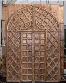 Sale 9160H - Lot 67 - A pair of Moroccan carved pine doors, with studded lattice decorations,  Height 320cm x total Width 247cm