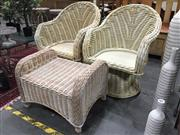 Sale 8889 - Lot 1408 - Pair of Cane Tub Chairs with Ottoman
