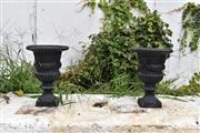 Sale 8950G - Lot 59 - A pair of black cast iron urns 31cm Height 21cm Wide