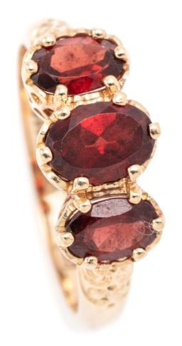 Sale 9145 - Lot 337 - A VICTORIAN STYLE THREE STONE GARNET RING; beaded claw set in 9ct gold with 3 oval cut spessartite garnets on a pierced gallery, siz...
