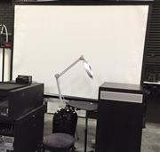 Sale 8222 - Lot 41 - A projector screen with collapsible stand, w of screen 254, h of stand 184cm