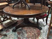 Sale 8693 - Lot 1088A - Early Victorian Rosewood Supper Table, with round top with gun barrell pedestal on triform base with claw feet with castors