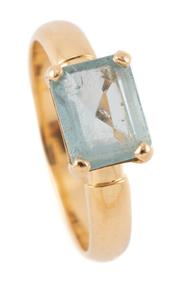 Sale 9095 - Lot 307 - AN 18CT GOLD SOLITAIRE AQUAMARINE RING; featuring an emerald cut aquamarine of approx. 1.63ct, on a plain 3.2mm rounded shank, size...