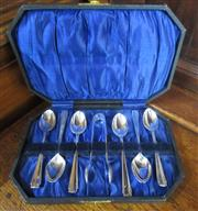 Sale 8298 - Lot 79 - A cased set of 6 silverplate teaspoons with sugar tongs.