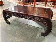 Sale 8693 - Lot 1074 - Chinese Rosewood Kang Table, with carved apron & rolled in legs joined by stretchers