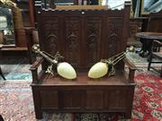 Sale 8882 - Lot 1078 - Oak Monks Storage Bench, the back with crenelated top and four carved panels of pious figures, above a hinged seat and linen-fold p...