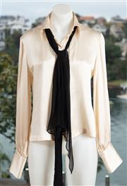 Sale 9044H - Lot 53 - A Carla Zampatti ivory silk blouse size 8 together with a Calvin Klein silk blouse (some marking)