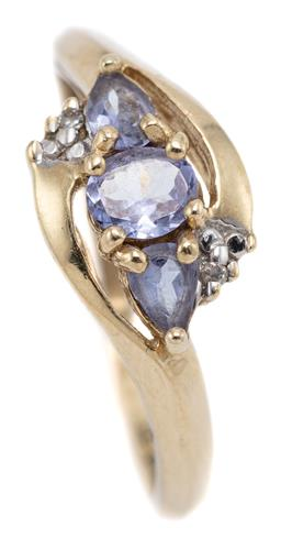 Sale 9124 - Lot 581 - A 10CT GOLD TANZANITE AND DIAMOND RING; set with an oval and 2 pear cut tanzanites totalling approx. 0.70ct on bypass shoulders each...