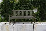 Sale 9087H - Lot 230 - A teak bench with aged patina. 1.5m left to leg