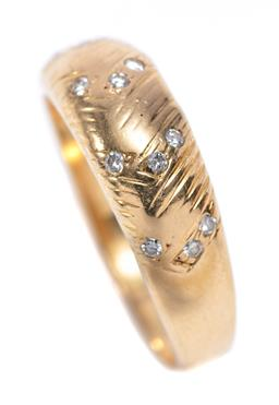 Sale 9253J - Lot 422 - AN 18CT GOLD DIAMOND RING; 6.5mm wide tapering band set with 12 round brilliant cut diamonds, size Q, wt. 3.61g.