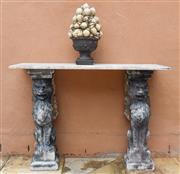 Sale 9040H - Lot 103 - A marble topped console table with stoneware gargoyles to each end. Residual aged gilding to each gargoyle 77cm height 1.06m wide  3...