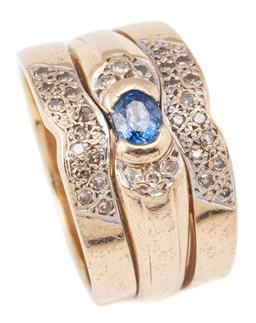 Sale 9124 - Lot 502 - A 9CT GOLD SAPPHIRE AND DIAMOND RING; three band ring suite (soldered together), middle ring part rub set with an oval cut blue sapp...
