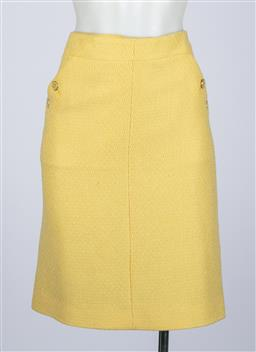 Sale 9095F - Lot 73 - A classic Chanel lemon coloured skirt with two front pockets with CC buttons, size 10.