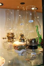 Sale 8306 - Lot 82 - Three Kerosene Lamps