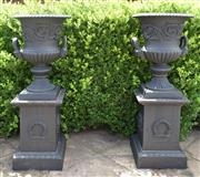 Sale 8950G - Lot 63 - Pair of cast iron campagna urns on plinths 1.12m Height  top of base is 35cm by 35cm