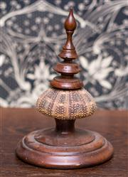 Sale 8222 - Lot 54 - A timber mounted sea urchin finial, H 18cm Film Provenance; Australia, 2008