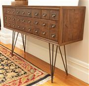 Sale 8863H - Lot 38 - An apothecary mid-century style console with aged metal accent handles and hairpin legs. Each drawer is three handles wide and some...