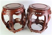 Sale 8912H - Lot 41 - A pair of Chinese Hongmu drumstools, each raised on five short feet with attractive grain. Height 45cm x Diameter 39cm