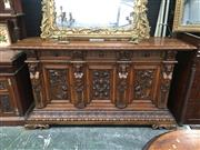 Sale 8882 - Lot 1091 - Renaissance Style Carved Walnut Sideboard, with three drawers & three gryphon panel doors, flanked by male and female caryatid figures