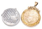 Sale 8905J - Lot 360 - TWO ANTIQUE LOCKETS; one gold cased with fine scroll engraving other in sterling silver hallmarked Birmingham 1919, widths 26-29mm.