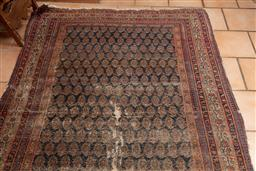 Sale 9120H - Lot 148 - A vintage Persian carpet in worn condition, with boteh motif on navy ground, 270cm x 152cm