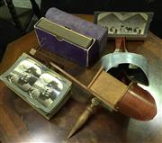 Sale 8222 - Lot 101 - Two vintage stereoscopes with a collection of viewing cards, including architectural