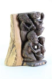 Sale 8957 - Lot 19 - A Carved Timber Story Block (H 22cm)