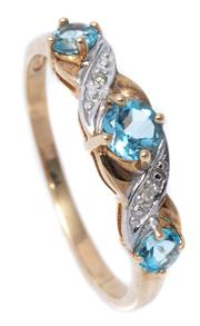 Sale 8982 - Lot 334 - A 9CT GOLD GEMSTONE RING; set with blue topaz and 2 round brilliant cut diamonds, size R-S, wt. 2.02g.