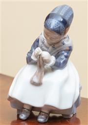 Sale 9055H - Lot 63 - A Royal Copenhagen figure of a seated knitting lady. H:16cm.